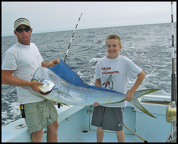 Boy holding his catch of mahi