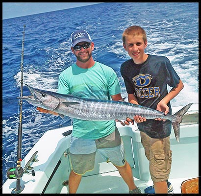 young angler who just caught a wahoo