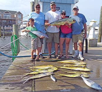 family with their catch on the dock at Hatteras Harbor