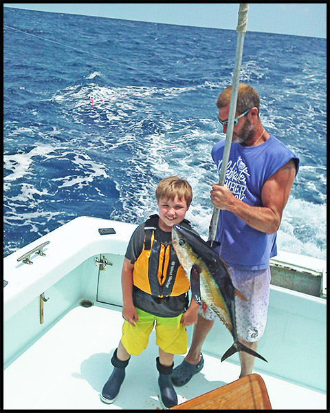 young boy with his yellowfin tuna boated